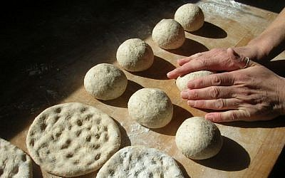 Julie Sperling working the matzah dough at the Naga Bakehouse in Vermont. (Courtesy Naga Bakehouse via JTA)