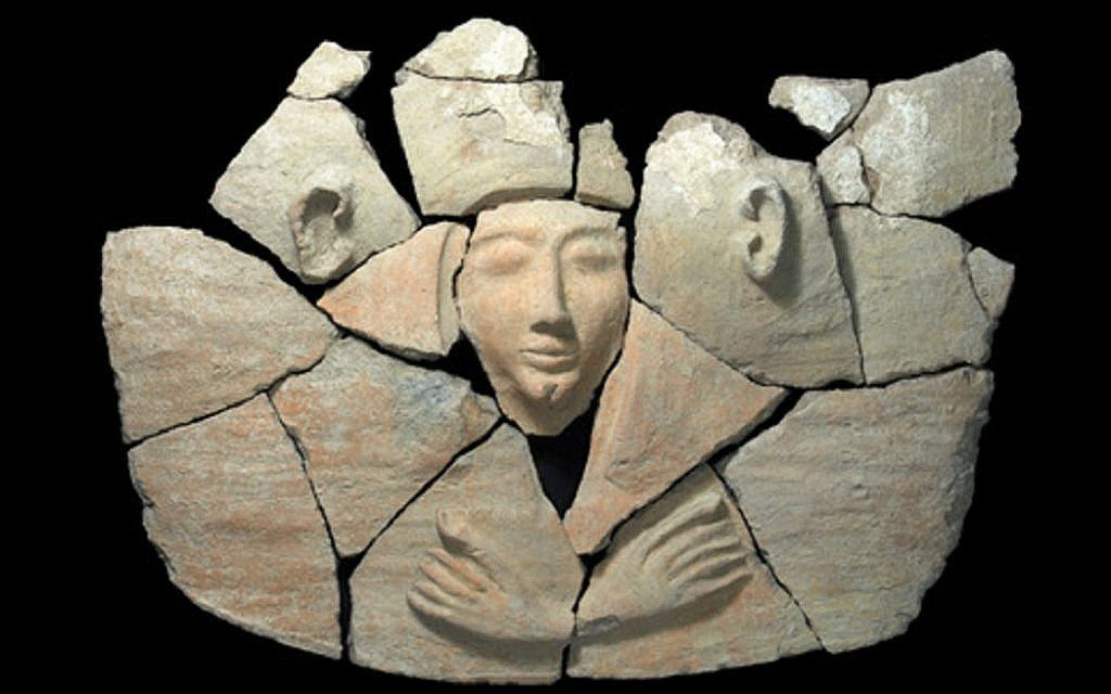 Parts of the anthropoid coffin's lid after an initial cleaning. (photo credit: Clara Amit, courtesy of the Israel Antiquities Authority)