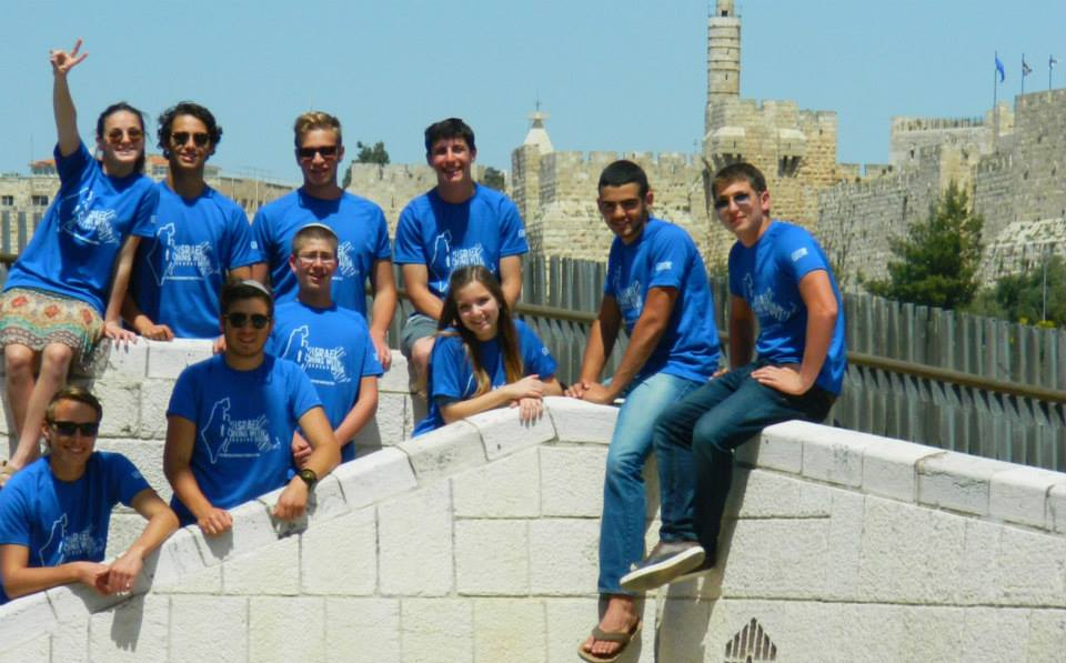 Last week, American and Israeli students in Jerusalem posed in new 'Israel Runs with Boston' T-shirts created through the Jerusalem-based NU Campaign. Up to 200 Boston college students are expected to wear these shirts at the Boston Marathon on Monday (photo courtesy: David Kramer)