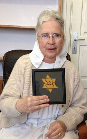 Sister Gratia holds the Yellow Star given her by an Austrian Holocaust survivor. (photo credit: Renee Ghert-Zand)