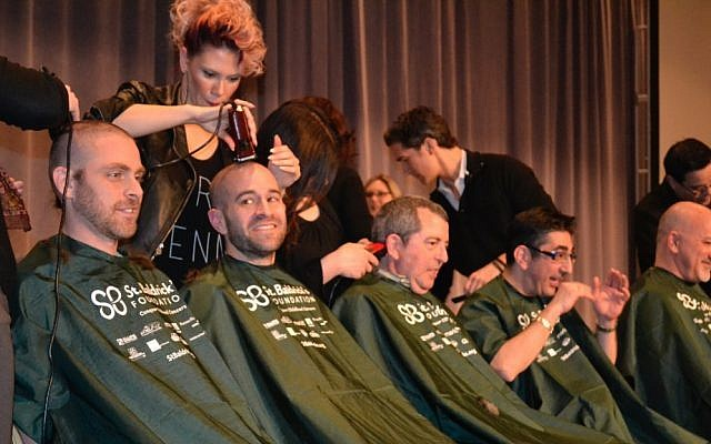 An assembly line of rabbis get their heads shaved at the CCAR convention in Chicago. (photo credit: JTA/Julie Pelc Adler)