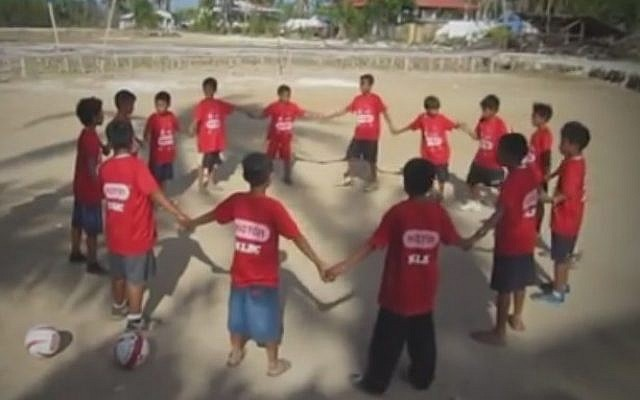 Children in the Philippine island of Bantayan play soccer with Israeli instructors from the Mifalot organization (Photo credit: Youtube screen capture)