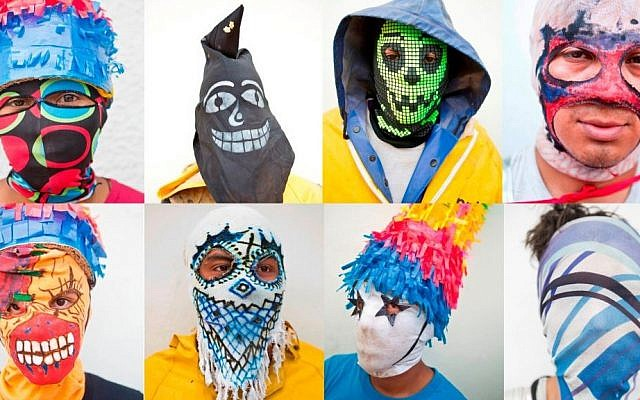 Illustrative photo of youths wearing hand made masks. (Photo credit: Esteban Felix/AP)