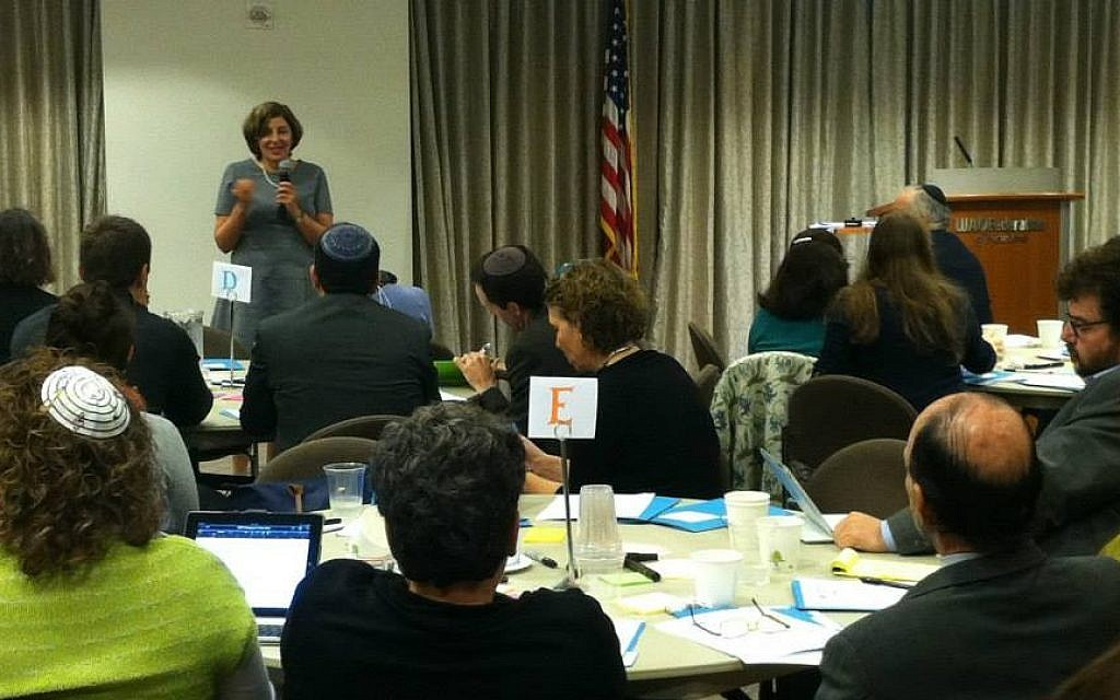 Shifra Bronznick, founder and president of Advancing Women Professionals, speaks at a conference sponsored by the advocacy group, October 2013. (Courtesy Advancing Women Professionals)