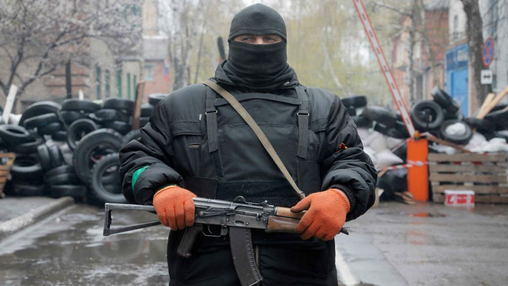 A pro-Russian gunman stands guard at a seized police station in the eastern Ukraine town of Slovyansk. (photo credit: AP Photo/Efrem Lukatsky)