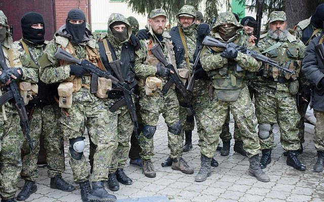 Armed pro-Russian activists pose for a photo after they occupied the police station in the eastern Ukraine town of Slovyansk. (photo credit: AP/Maxim Dondyuk, Russian Reporter magazine)