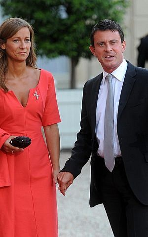 Manuel Valls, then the interior minister of France, arrives at a state dinner with his wife, Anne Gravoin, Sept. 3, 2013. (photo credit: Antoine Antoniol/Getty Images/JTA)