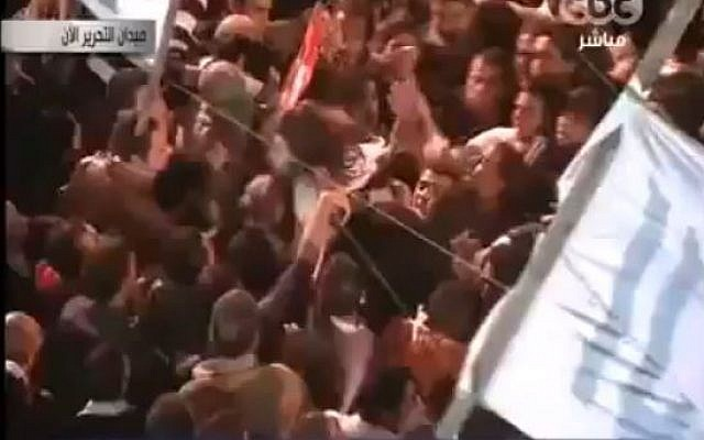 Video allegedly showing a woman being attacked by a mob in Tahrir Square, Cairo, November 2011. (screen capture: YouTube/bydesign001)
