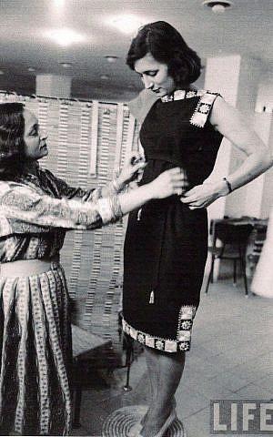 Yael Dayan, Ruth Dayan's daughter, trying on a Maskit dress (Courtesy Maskit)
