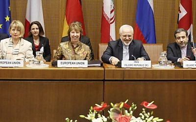 (L-R) EU Deputy Secretary General Helga Schmid, President of the European Commission Catherine Margaret Ashton, Iranian Foreign Minister Mohammad Javad Zarif, and Iranian ambassador to Austria Hassan Tajik attend the P5+1 with Iran at the UN headquarters in Vienna, Wednesday, May 14, 2014. (photo credit: Dieter Nagl/AFP)
