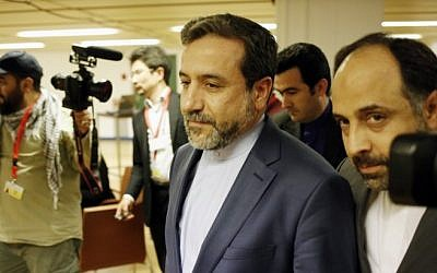 Abbas Araghchi (C), Iran's chief nuclear negotiator arrives at the Austria Center Vienna after another rounds of talks between the EU 5+1 on May 16, 2014 in Vienna. (photo credit: AFP/DIETER NAGL/file)