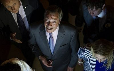 UK Independence Party (UKIP) leader Nigel Farage attends the Southampton Guildhall announcement of the South East England region results from the European Parliament elections in Southampton, southern England, on May 25, 2014. (Photo credit: AFP/Carl Court)