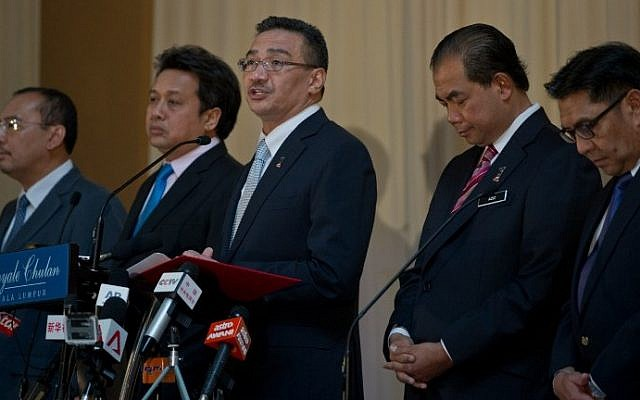 Malaysian Minister of Defence and Acting Transport Minister Hishammuddin Hussein (C) speaks during a press conference on the missing Malaysia Airlines flight MH370 in Kuala Lumpur on May 15, 2014, the day the hunt for the missing passenger jet in the Indian Ocean was put on hold. (photo credit: AFP Photo/Mohd Rasfan)