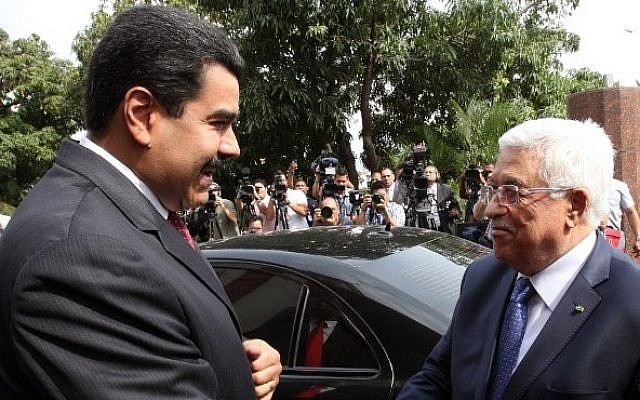 Venezuelan President Nicolas Maduro (left) welcomes Palestinian Authority President Mahmoud Abbas upon his arrival at the Miraflores presidential palace in Caracas on May 16, 2014 (Photo credit: Presidencia/AFP)