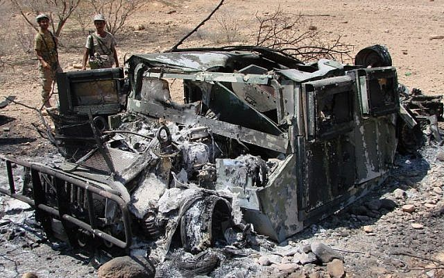 This image taken on May 1, 2014 and made available by the Yemeni Ministry of Defense on May 2, 2014, shows the wreckage of a vehicle following fighting between the Yemeni troops and suspected al-Qaeda militants near the southern Abyan province village of Maajala (photo credit: AFP/HO/Yemen Defense Ministry)