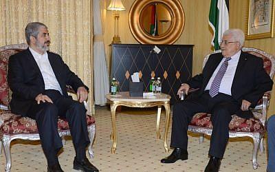 Palestinian leader Mahmoud Abbas, right, meeting with political bureau head of Hamas, Khaled Meshaal on May 5, 2014 in Doha, Qatar. (photo credit: AFP/ PPO/THAER GHANAIM)