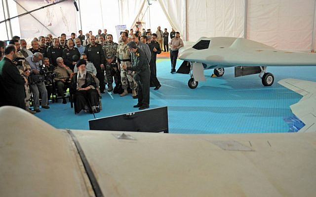 A photo released from the office of Iran's Supreme Leader Ayatollah Ali Khamenei on May 11, 2014 shows him (C-L) sitting next to the captured US RQ-170 sentinel high-altitude reconnaissance and its locally made copy at the Islamic Revolutionary Guard Corps Aerospace Force exhibition in Tehran.  (photo credit: AFP/HO/Iranian Leader's Website)