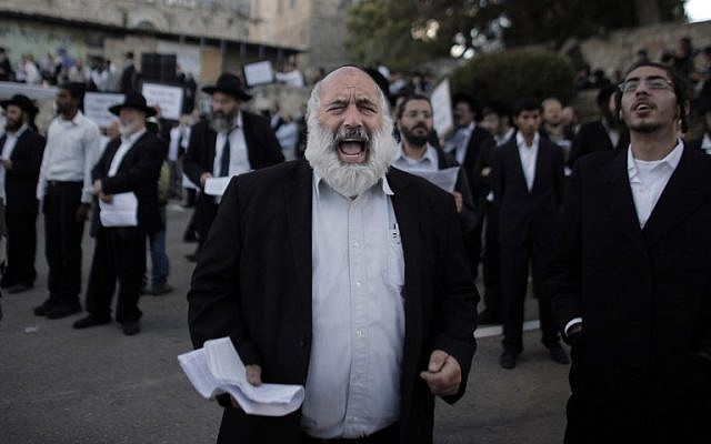 Ultra-Orthodox Jewish men protest against Pope Francis' upcoming visit to the Holy Land, on May 12, 2014 in the Old City of Jerusalem, near King David's tomb. (photo credit: AFP PHOTO/ AHMAD GHARABLI)