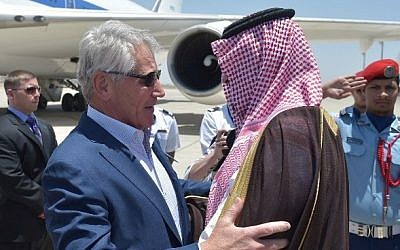 US Defense Secretary Chuck Hagel (L) is welcomed by Saudi Deputy Defense Minister Salman bin Sultan upon his arrival at Jeddah's King Abdulaziz International Airport on Tuesday, May 13, 2014. (photo credit: Mandel Ngan/AFP)