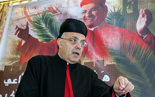 Maronite Archbishop of Haifa and the Holy Land Moussa el-Hage gestures during a press conference at his house in the northern Israeli coastal city of Haifa on May 14, 2014. (photo credit: AFP PHOTO / JACK GUEZ)