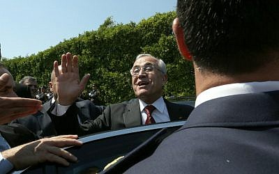 Lebanese President Michel Sleiman waves as he leaves the presidential palace in Baabda on the last day of his presidential mandate, on May 24, 2014. (photo credit: AFP/Anwar Amro)