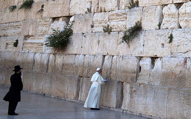 Pope Francis prays at the Western Wall in Jerusalem's Old City, Monday, May 26, 2014. (photo credit: AFP/THOMAS COEX)