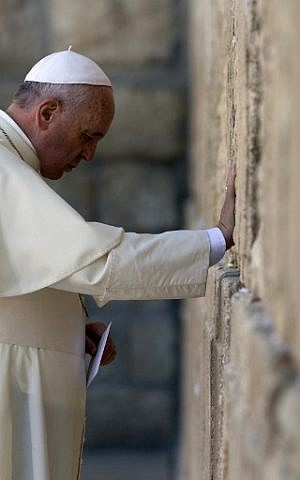 Pope Francis prays at the Western Wall, Judaism's holiest site, in Jerusalem's Old City on May 26, 2014. (photo credit: AFP/Thomas Coex)