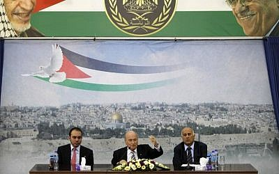 FIFA President Sepp Blatter sits between Prince Ali of Jordan (left), and Jibril Rajoub (right), who heads the Palestinian Football Federation, at the presidential headquarters in the West Bank city of Ramallah, on May 26, 2014. (photo credit: AFP/Abbas Momani)