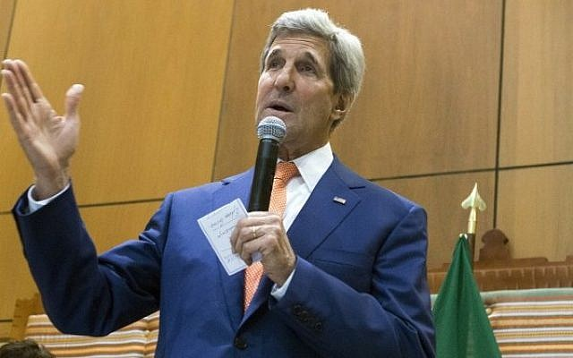 US Secretary of State John Kerry (R) stands alongside US Ambassador to Ethiopia Patricia Haslach as he speaks to US Embassy employees and their families at the US Embassy in Addis Ababa, Ethiopia, on May 1, 2014. (photo credit: AFP PHOTO / POOL / Saul LOEB)