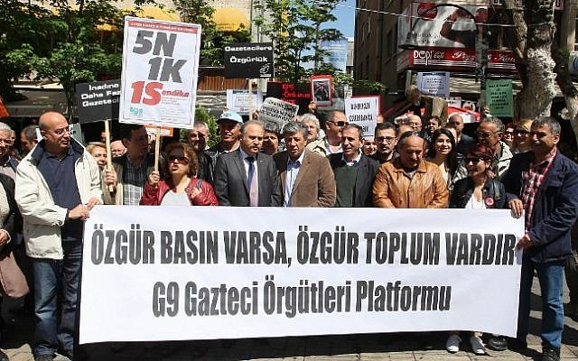 "File: Turkish journalists stand behind a banner reading ""If you have a free press, there is a free society -- the Gaztec organizations G9 Platform"" (a journalists' association) as they protest against attacks on journalists and in support of freedom of the press during a demonstration in Ankara on May 3, 2014. (Adem Altan/AFP)"