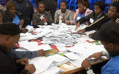 Independent Electoral Commission officials count ballots after voting in South Africa's fifth democratic general election was closed at the Langa polling station in Cape Town on May 7, 2014.  (photo credit: AFP/RODGER BOSCH)