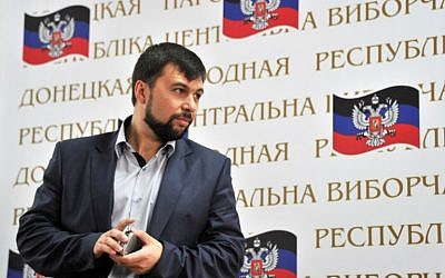 Denis Pushilin (C), the self-styled governor of so-called People's Republic of Donetsk takes part in a press conference to present the results of the referendums on the independence held in two regions of the eastern Ukraine the day before on May 12, 2014 in Donetsk . (photo credit: AFP PHOTO/ GENYA SAVILOV)