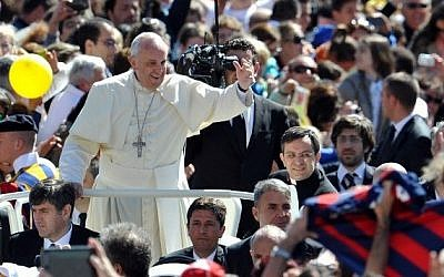 Pope Francis greets the crowd as he arrives for his general audience in St. Peter's Square at the Vatican, on May 14, 2014. (photo credit: AFP Photo/Tiziana Fabi)