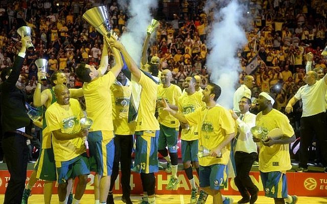 Maccabi Tel Aviv players celebrate their victory at the end of their Euroleague 2014 3rd place Final Four basketball game against Real Madrid, on May 18, 2014, at the Mediolanum stadium in Assago, Italy. (photo credit: Olivier Morin/AFP)