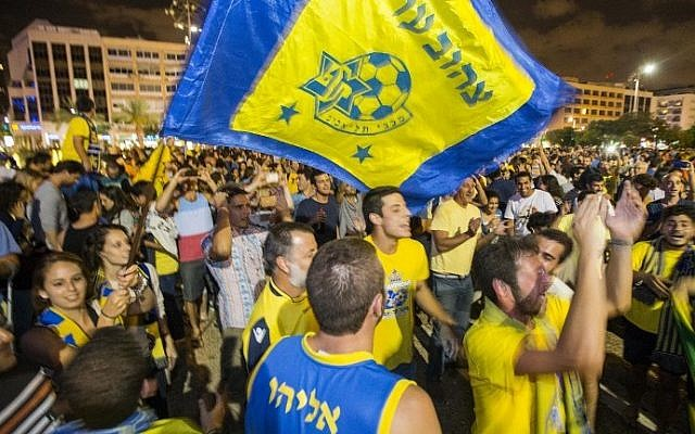 Maccabi Tel Aviv supporters gather in Kikar Rabin (Rabin Square) in Tel Aviv to celebrate the victory of their team after the Euroleague 2014 Final Four basketball match Maccabi Tel Aviv vs Real Madrid, played at Mediolanum Forum in Milan, on May 18, 2014. (photo credit: Jack Guez/AFP)