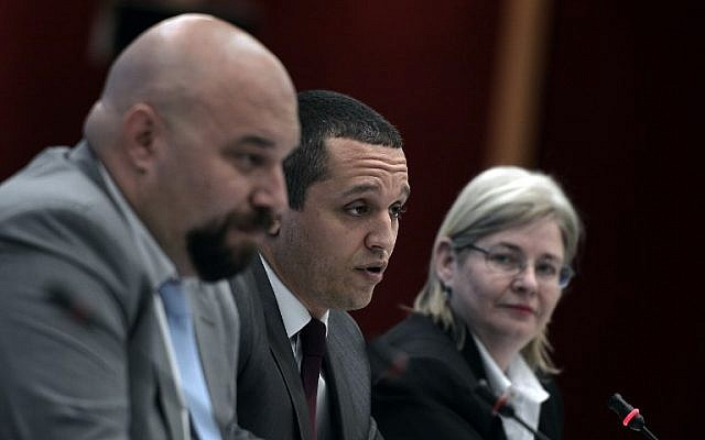 Golden Dawn far right party lawmaker Ilias Panagiotaros (L), party's spokesman and lawmaker Ilias Kasidiaris (C) and party's lawmaker and wife of jailed leader Eleni Zaroulia give a televised press conference in Athens ahead of the EU elections and the second round of local elections, in 2014 .(photo credit: AFP/Louisa Gouliamaki)