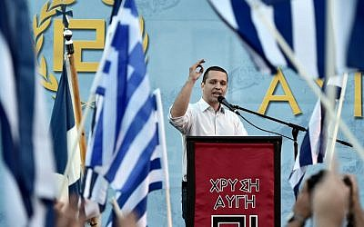Spokesman of the Greek ultra nationalist party Golden Dawn Iias Kasidiaris delivers a speech during a pre-election rally in Athens on May 23, 2014 (photo credit: AFP/ARIS MESSINIS)
