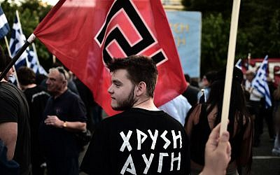 Supporters of the Greek ultra nationalist party Golden Dawn (AFP/Aris Messinis)