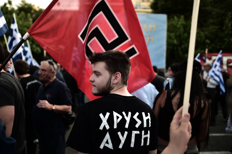 Supporters of the Greek ultra nationalist party Golden Dawn attend a pre-election rally in Athens on May 23, 2014 (photo credit: AFP/ARIS MESSINIS)
