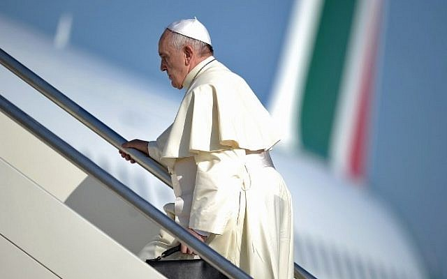Pope Francis walks to the top of the stairs leading to his plane as he leaves Rome for the Middle East on Saturday, May 24, 2014 (photo credit: Filippo Monteforte/AFP)