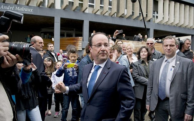 French President Francois Hollande (C) leaves a polling station after casting his ballot for the European Parliament elections on May 25, 2014 in Tulle, centralwestern France. (photo credit: AFP PHOTO/ ALAIN JOCARD)