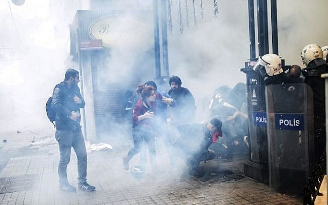 Turkish riot police use tear gas to disperse protesters gathered on the central Istoklal avenue near Taksim square in Istanbul, on May 31, 2014 (photo credit: AFP/BULENT KILIC)