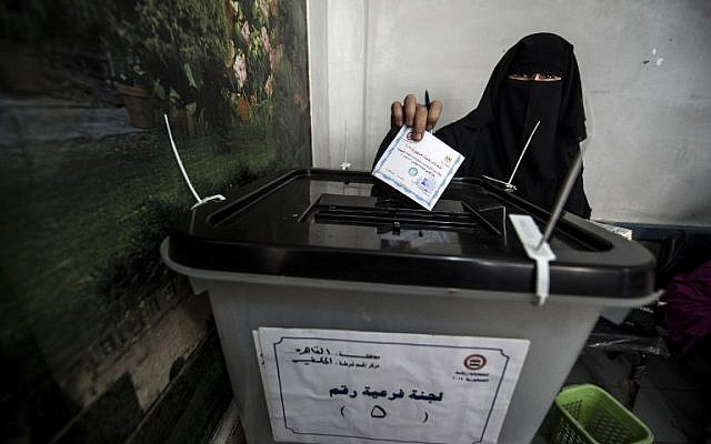 An Egyptian woman casts her vote at a polling station next to the historical Mohamed Ali citadel in the capital Cairo on May 26, 2014. (photo credit: AFP/KHALED DESOUKI)