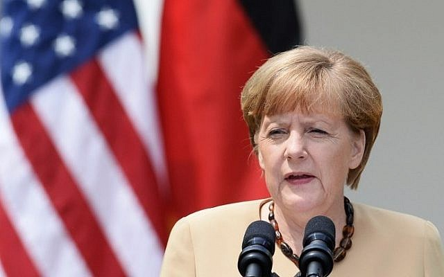 German Chancellor Angela Merkel speaks during a visit to the White House on May 2, 2014 (Photo credit: Jewel Samad/AFP)