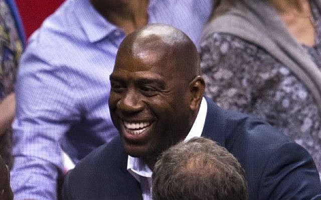 Magic Johnson attends game 4 of the NBA playoff series between the Los Angeles Clippers and the Oklahoma City Thunder, May 11, 2014, at the Staples Center in Los Angeles, California. (photo credit: AFP/ Robyn Beck)