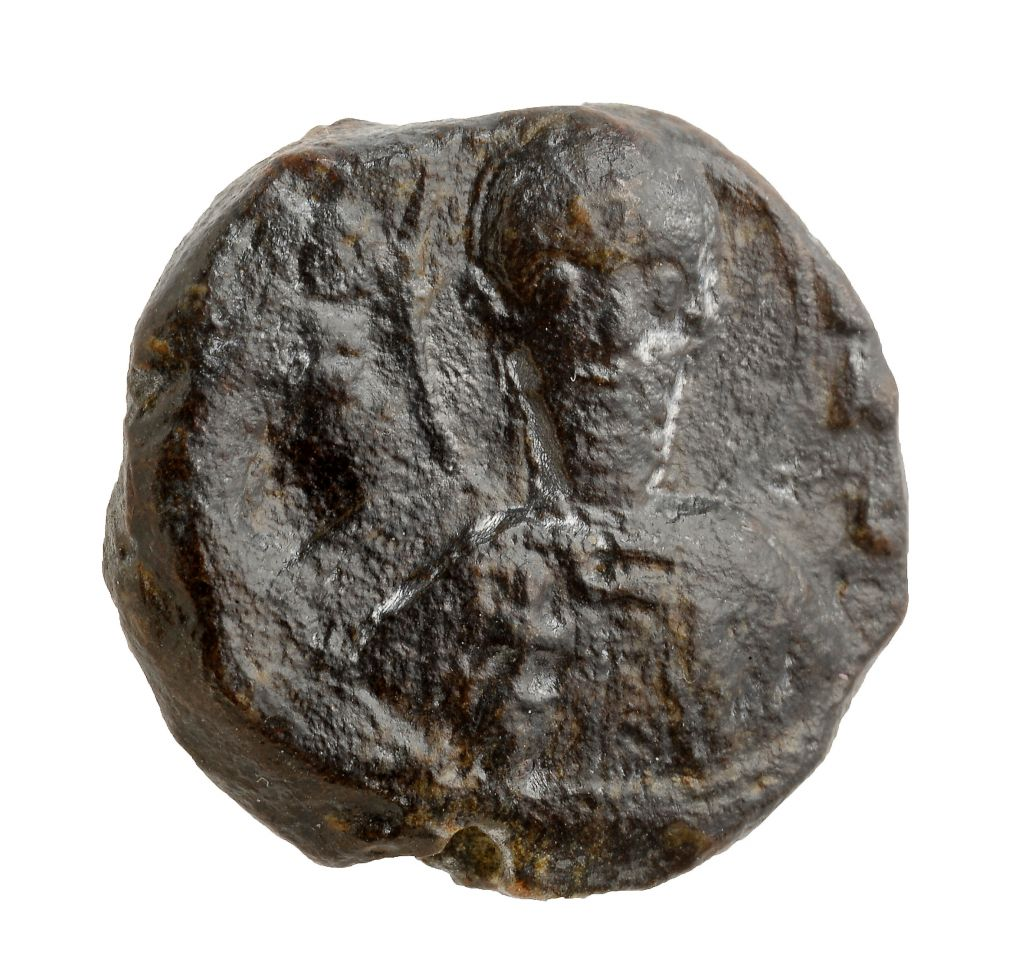 One side of the Crusader-era seal of St. Sabas monastery discovered in Jerusalem's Bayit Vegan neighborhood. (photo credit: Clara Amit/Israel Antiquities Authority)