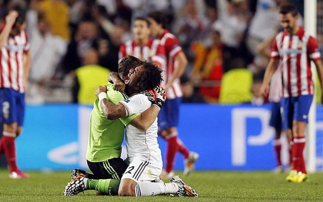 Real Madrid's Marcelo, center right, and goalkeeper Iker Casillas celebrate during the Champions League final soccer match against Atletico Madrid at the Luz stadium in Lisbon, Portugal, Saturday, May 24, 2014. (Photo credit: AP/Daniel Ochoa de Olza, File)