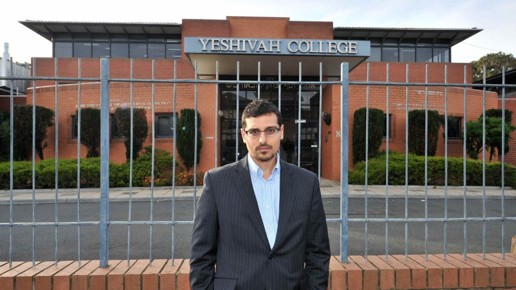 Manny Waks, the founder of Tzedek, an Australian advocacy group for Jewish victims of sexual abuse, in front of Melbourne's Yeshivah College, which has been rife with allegations of abuse. (News Corp. courtesy of Manny Waks)