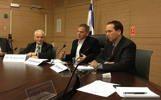 Yaşar Yakış (left) meets with members of the Knesset in Jerusalem, May 20, 2014 (photo credit: Elhanan Miller/TOI staff)