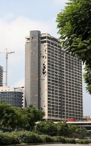 The old Holiday Inn in Beirut clearing showing the extensive damage it suffering during the Lebanese Civil War. (photo credit: CC BY SA Giorgio Montersino/Flickr)
